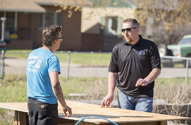 Two men talking at a Montana Deconstruction work site.