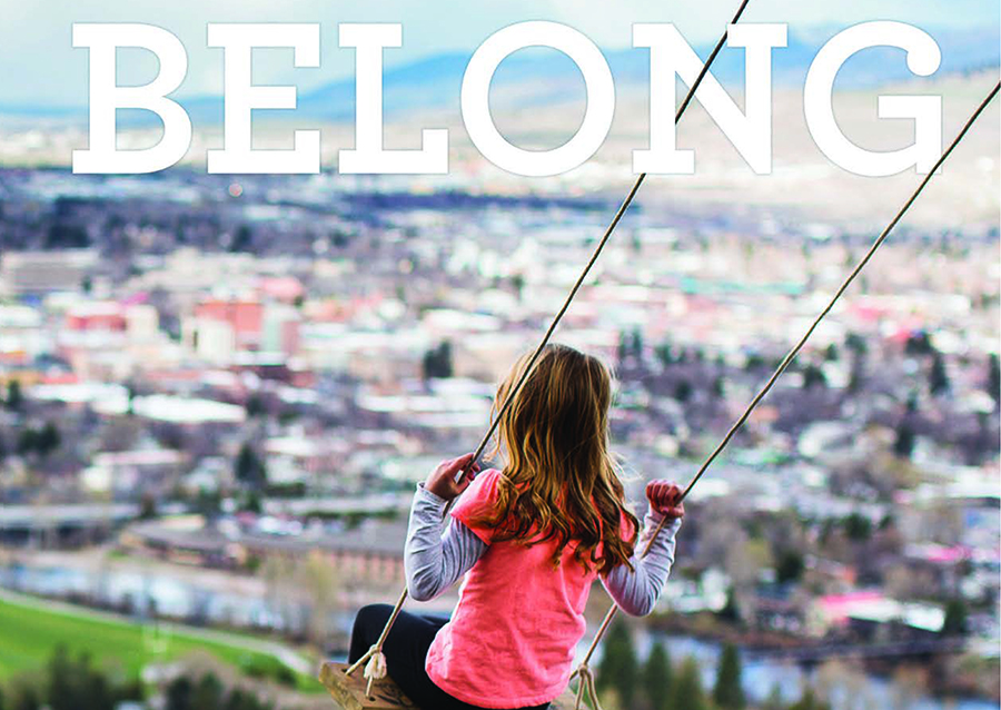"Magazine cover featuring a young girl on a swing with the title, ""Belong"" at the top of the image."