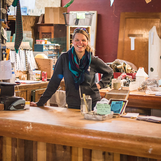 smiling woman standing inside her business