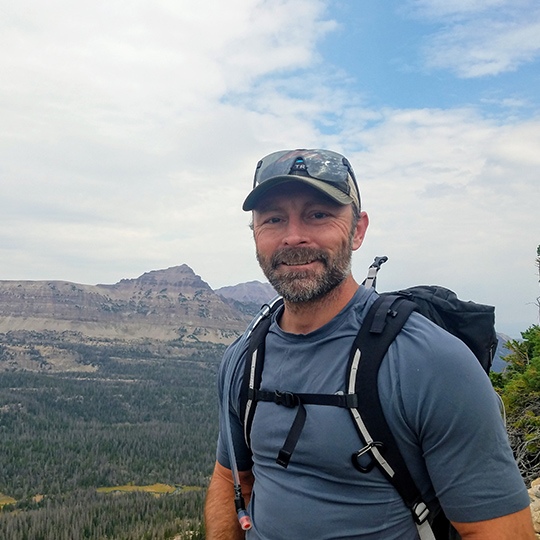 Missoula FCU Executive Team Member Clinton Summers hiking outdoors