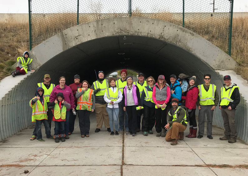 Employees pose for a photo after an Adopt-A-Highway clean up.