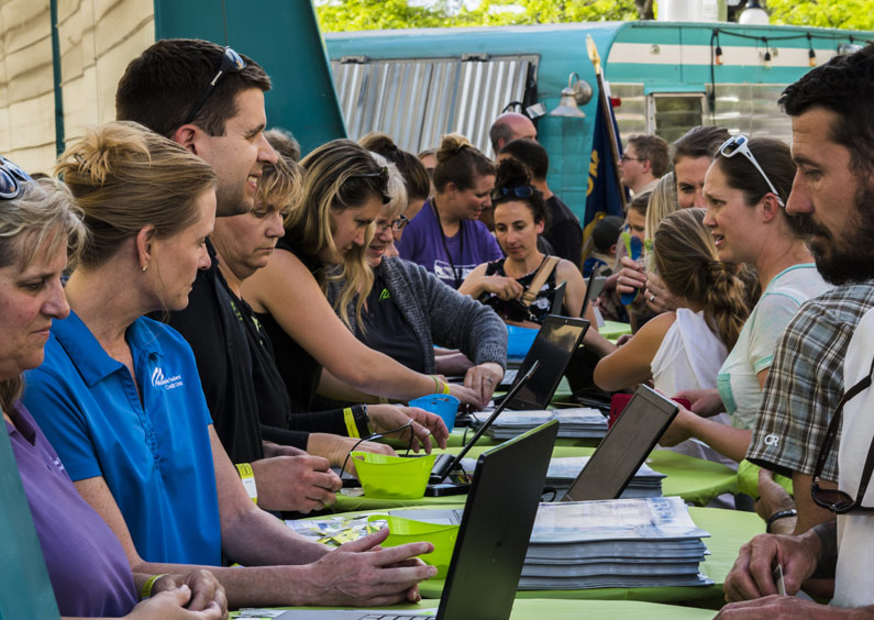 MFCU staff checking members in to the 2018 MFCU Member Meeting at Caras Park, Missoula, Montana.