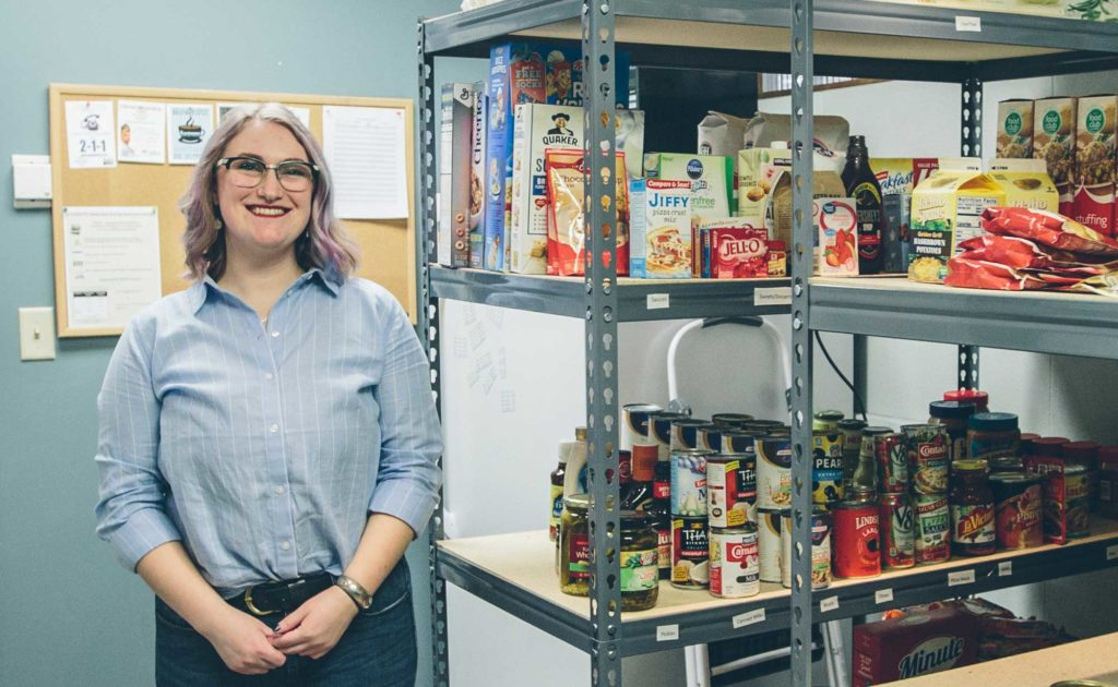 Photos of the UM Food Pantry Coordinator, Kat Cowley standing next to shelves of food.