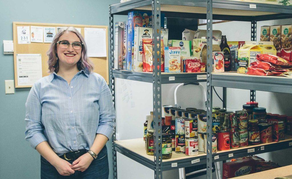 Photos of the UM Food Pantry Coordinator, Kat Cowley standing next to shelves of food.