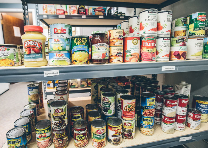 Shelves stocked with cans of food.