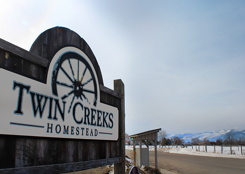 """Sign with words """"Twin Creeks Homestead""""."""