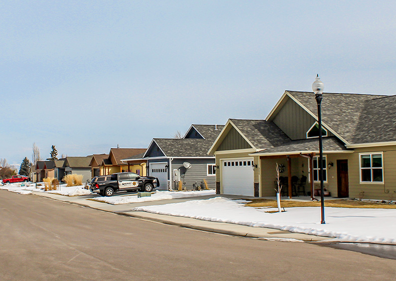 View of houses down a street at the Twin Creeks Subdivision in Stevensville, MT.